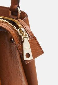 DKNY - SATCHEL - Handbag - caramel - 4