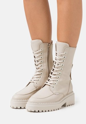 FAE AUBINE - Platform ankle boots - desert
