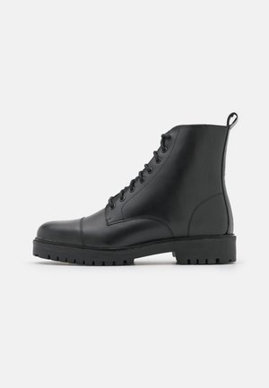 COLE TOE CAP - Lace-up ankle boots - smooth black