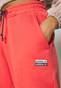 adidas Originals - Tracksuit bottoms - coral - 5
