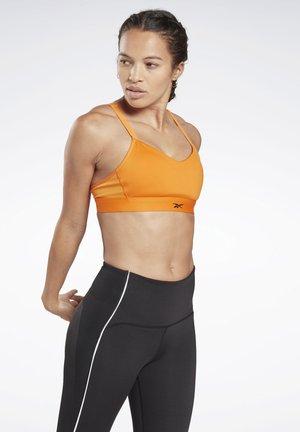 REEBOK HERO MEDIUM-IMPACT STRAPPY BRA - Sports bra - orange