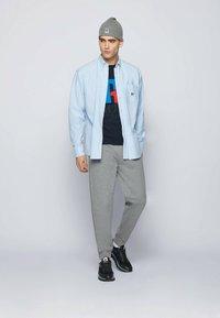 BOSS - Print T-shirt - dark blue - 1