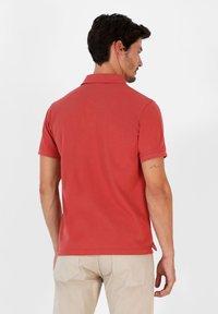 Scalpers - Polo shirt - terracotta - 2