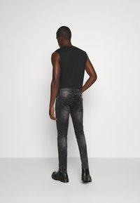 Tigha - MORTY STONE WASH - Slim fit jeans - vintage black - 2