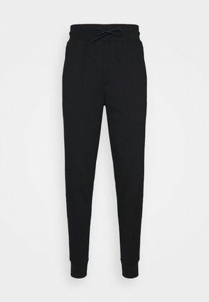 DAKY - Spodnie treningowe - black