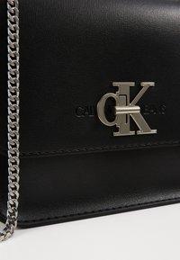 Calvin Klein Jeans - MEDIUM FLAP CHAIN - Across body bag - black - 4