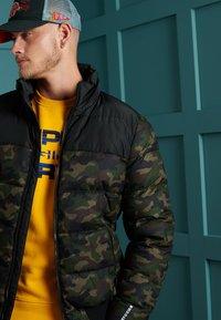 Superdry - TRACK SPORT PUFFER - Winter jacket - camo/black - 2