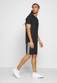 adidas Performance - MIX TEE - Print T-shirt - black/white - 1