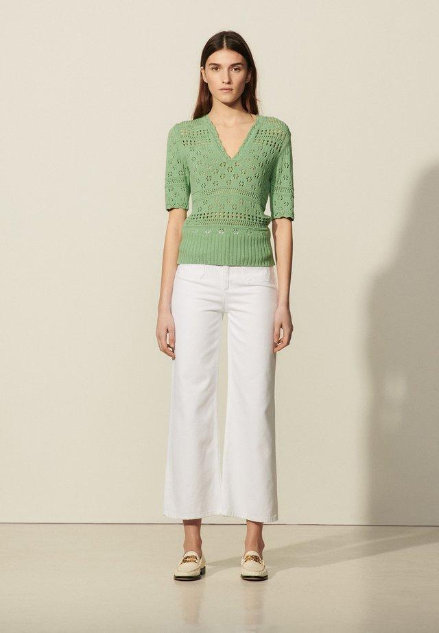 JOE - T-shirt med print - vert amande