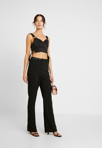 4th & Reckless - MELODY TROUSER - Pantaloni - black structured - 1