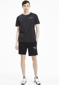 Puma - ATHLETICS  - Shorts - black - 1