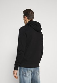 Tommy Hilfiger - CIRCLE CHEST HOODY - Felpa con cappuccio - black - 2