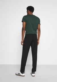 Selected Homme - SLHSLIMTAPERED JAMES - Suit trousers - black - 2