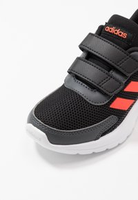 adidas Performance - TENSAUR RUN UNISEX - Neutral running shoes - core black/solar red/grey six - 2