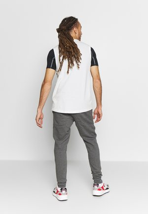 RIVAL HERREN - Tracksuit bottoms - charcoal light heather