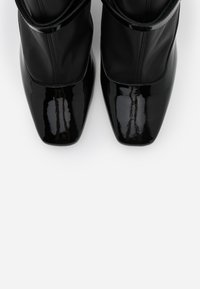 MOSCHINO - High heeled ankle boots - nero - 4
