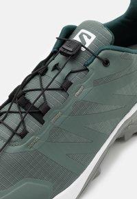 Salomon - SUPERCROSS - Trail running shoes - balsam green/white/monument - 5