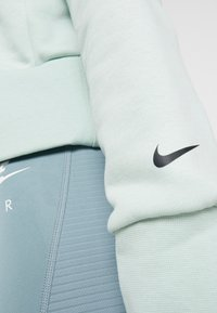 Nike Performance - DRY GET FIT LUX - Mikina - pistachio frost - 5