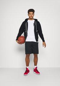 Nike Performance - ISSUE HOODIE - Zip-up sweatshirt - black/pale ivory - 1