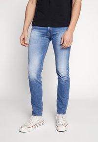 Diesel - THOMMER-X - Slim fit jeans - blue denim - 0