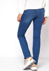 TONI - Slim fit jeans - midblue used - 1