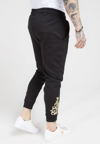 SIKSILK - FITTED  - Tracksuit bottoms - jet black/gold - 4