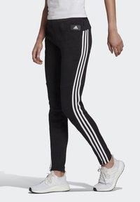 adidas Performance - ADIDAS SPORTSWEAR 3-STRIPES SKINNY PANTS - Pantalon de survêtement - black/white - 0
