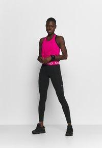 Nike Performance - DRY ELASTIKA TANK - T-shirt de sport - fireberry/black - 1
