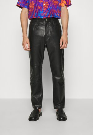 ABNERE  - Leather trousers - black
