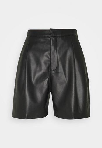 KARLEE - Shorts - black