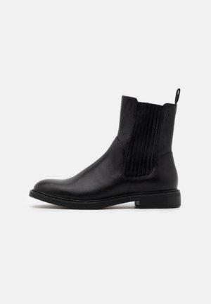 AMINA - Kotníkové boty - black