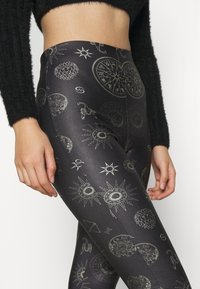 Topshop - ASTROLOGY FLARE - Leggings - Trousers - black - 6