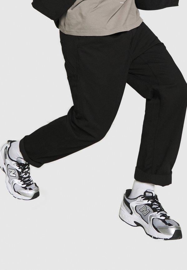 Carhartt WIP CARSON PANT MORAGA - Spodnie materiałowe - black stone washed/czarny Odzież Męska CLYY