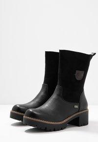 Rieker - Classic ankle boots - schwarz/kastanie - 4