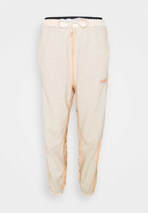 UPFIELD TRACKPANT - Tracksuit bottoms - tender peach