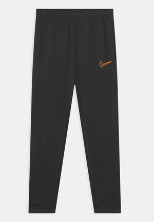 ACADEMY WINTERIZED UNISEX - Spodnie treningowe - black/total orange