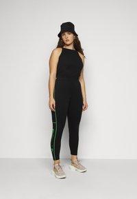 Nike Sportswear - Leggings - Trousers - black/poison green - 1
