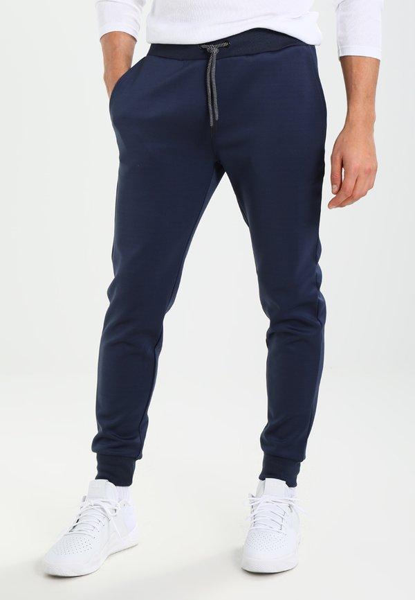 Pier One Spodnie treningowe - dark blue/granatowy Odzież Męska CTOG