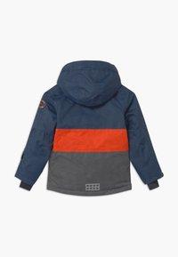 LEGO Wear - JOSHUA UNISEX - Winter jacket - light blue - 1