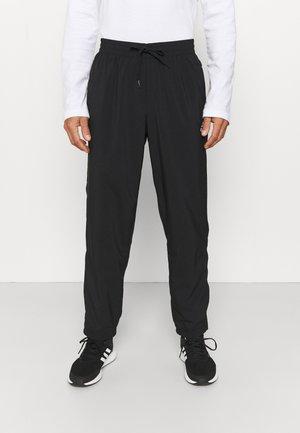 STANFORD ESSENTIALS AEROREADY - Spodnie treningowe - black