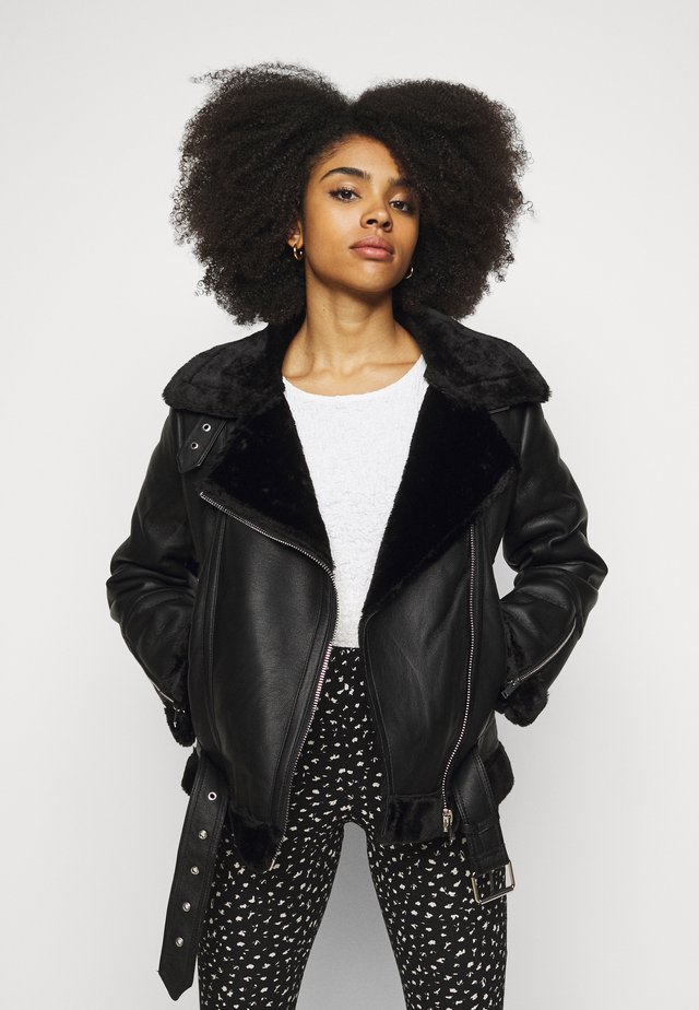 CASSY - Faux leather jacket - black