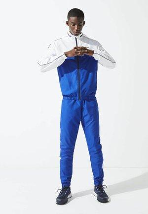 Trainingspak - bleu / blanc / bleu marine