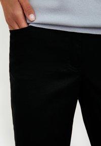 Finn Flare - Trousers - black - 3
