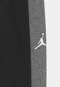 Jordan - AIR SPECKLE PANTS - Pantaloni sportivi - black - 2
