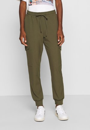 SILINA  - Tracksuit bottoms - grape leaf