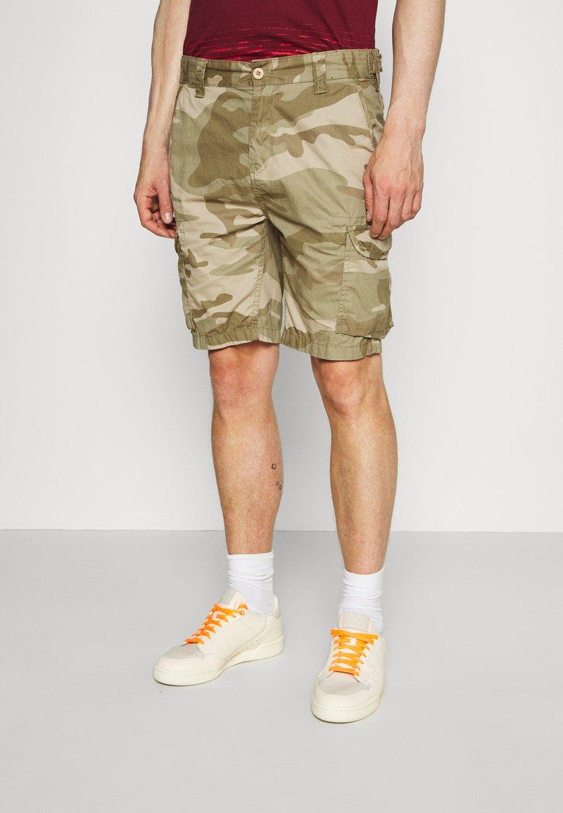 Schott - TROLIMPO - Shorts - beige