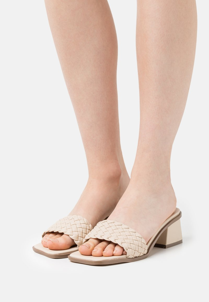 Nly by Nelly - BRAIDED SLIP IN - Heeled mules - creme