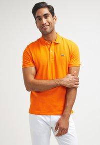 Lacoste - Polo shirt - mango chine - 0