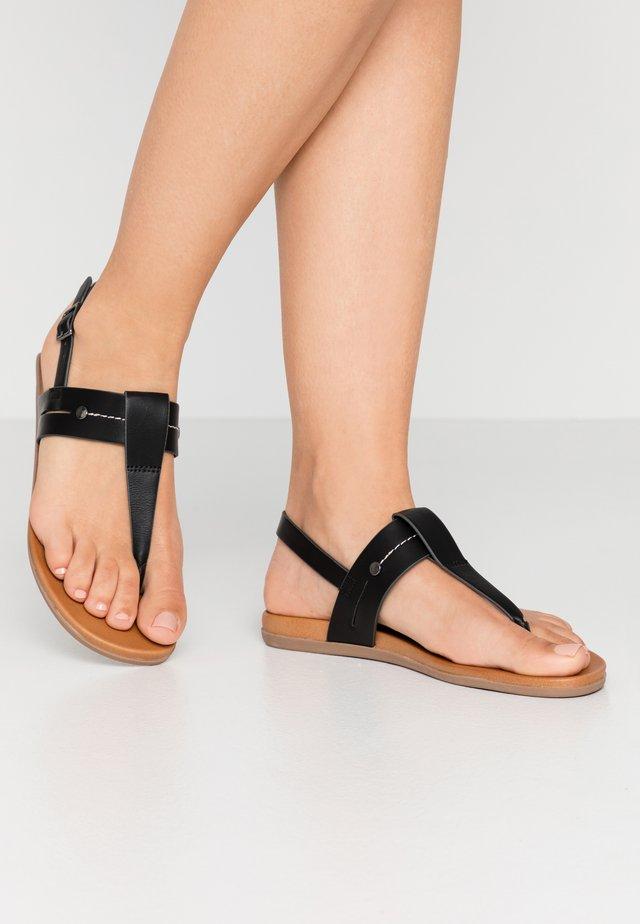 SAGEE - Sandalias de dedo - black