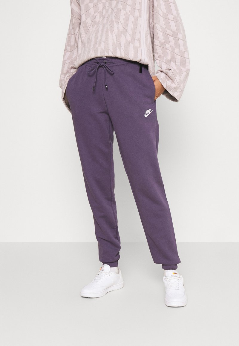 Nike Sportswear - Tracksuit bottoms - dark raisin/white